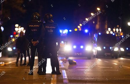 Riot police stand at the Via Laietana during a protest against the sentence ruled by Supreme Court on 'proces' trial' in Barcelona, Spain, 14 October 2019. Demonstrators are blocking also some roads in Catalan capital against the court's decision. Spanish Supreme Court condemned Oriol Junqueras to 13 years in jail for sedition, Carme Forcadell to 11 years and half for sedition; Jordi Cuixart and Jordi Sanchez were sentenced to nine and a half years for sedition; former regional Minister Jordi Turull, Raul Romeva and Dolors Bassa were sentenced to 12 years in jail for sedition and missapropriation, and Joaquin Forn and Josep Rull were condenmend 10 years an half for sedition. The three other defendants were absolved.