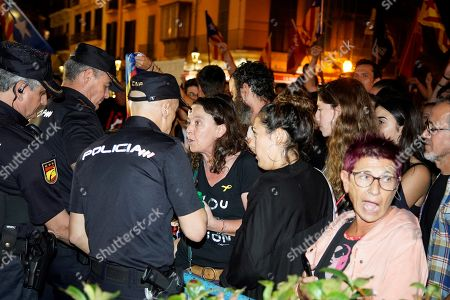 Members of Police talk with people that attend to the Cort de Palma de Mallorca square, to demonstrate against the sentence ruled by Supreme Court on 'proces' trial in Palma de Mallorca, Spain, 14 October 2019. Spanish Supreme Court condemned Oriol Junqueras to 13 years in jail for sedition, Carme Forcadell to 11 years and half for sedition; Jordi Cuixart and Jordi Sanchez were sentenced to nine and a half years for sedition; former regional Minister Jordi Turull, Raul Romeva and Dolors Bassa were sentenced to 12 years in jail for sedition and missapropriation, and Joaquin Forn and Josep Rull were condenmend 10 years an half for sedition. The three other defendants were absolved.