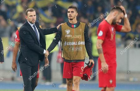 Ukraine's head coach Andriy Shevchenko, left, pats Portugal's Andre Silva after the Euro 2020 group B qualifying soccer match between Ukraine and Portugal at the Olympiyskiy stadium in Kyiv, Ukraine