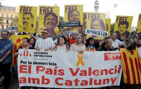 People show a banner that reads 'El Pais Valencia amb Catalunya' (lit. Valencian Country with Catalunya), during a rally called by the group called 'Accio Cultural del Pais Valencia' (Cultural Action of the Valencian Country) against the sentence ruled by Supreme Court on 'proces' trial', in Valencia, Spain, 14 October 2019. Demonstrators are blocking some roads in Catalan capital against the court's decision. Spanish Supreme Court condemned Oriol Junqueras to 13 years in jail for sedition, Carme Forcadell to 11 years and half for sedition; Jordi Cuixart and Jordi Sanchez were sentenced to 9 years and half for sedition; former regional Minister Jordi Turull, Raul Romeva and Dolors Bassa were sentenced to 12 years in jail for sedition and missapropriation, and Joaquin Forn and Josep Rull were condenmend to 10 years an half for sedition. The three other defendants were absolved.