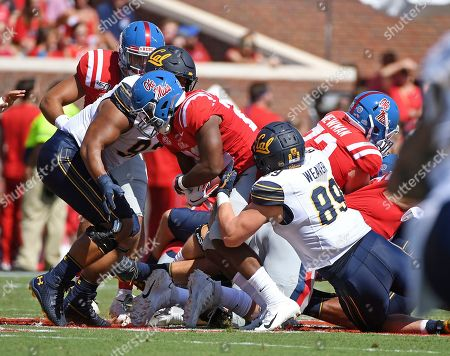 Evan Weaver, Scottie Phillips. California linebacker Evan Weaver (89) tackles Mississippi running back Scottie Phillips (22) during the first half of an NCAA college football game in Oxford, Miss