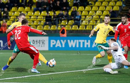 Stock Picture of Serbia's Adem Ljajic, left, kicks the ball ahead of Lithuania's goalkeeper Vytautas Cerniauskas during the Euro 2020 group B qualifying soccer match between Lithuania and Serbia at LFF stadium in Vilnius, Lithuania