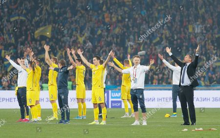 Ukrainian players together with head coach Andriy Shevchenko (R) thank their fans after the UEFA Euro 2020 qualifying, group B, soccer match between Ukraine and Portugal in Kiev, Ukraine, 14 October 2019.