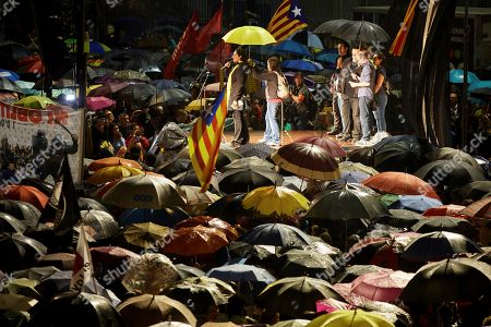 People attend a protest against the sentence ruled by Supreme Court on 'proces' trial' at 1st October square in Girona, Spain, 14 October 2019. Demonstrators are also blocking some roads in Catalan capital against the court's decision. Spanish Supreme Court condemned Oriol Junqueras to 13 years in jail for sedition, Carme Forcadell to 11 years and half for sedition; Jordi Cuixart and Jordi Sanchez were sentenced to 9 years and half for sedition; former regional Minister Jordi Turull, Raul Romeva and Dolors Bassa were sentenced to 12 years in jail for sedition and missapropriation, and Joaquin Forn and Josep Rull were condenmend 10 years an half for sedition. The three other defendants were absolved.