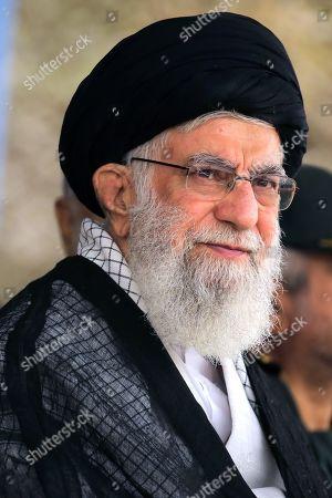 Iran's Supreme Leader Ayatollah Ali Khamenei attend a graduation ceremony for Iran's Islamic Revolutionary Guard Corps (IRGC) cadets at Imam Hussein University