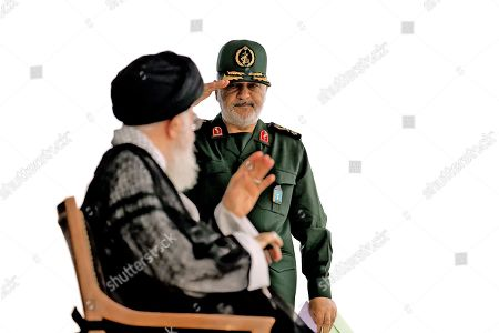 Iran's Supreme Leader Ayatollah Ali Khamenei and General Hossein Salami chief of the Revolutionary Guards attend a graduation ceremony for Iran's Islamic Revolutionary Guard Corps (IRGC) cadets at Imam Hussein University