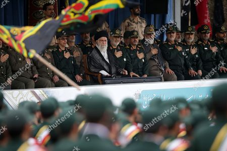 Stock Photo of Iran's Supreme Leader Ayatollah Ali Khamenei and General Hossein Salami chief of the Revolutionary Guards attend a graduation ceremony for Iran's Islamic Revolutionary Guard Corps (IRGC) cadets at Imam Hussein University