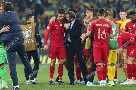 Portugal's Cristiano Ronaldo (L) with Ukraine head-coach Andriy Shevchenko after the  UEFA Euro 2020 qualifying round, Group B soccer match Ukraine vs Portugal at Olympic stadium, in Kiev, Ukraine, 14 October 2019.