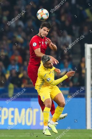 Ukraine's Marlos (R) in action against Portugal's Ruben Dias (L) during the UEFA Euro 2020 qualifying round, Group B soccer match against Ukraine at Olympic stadium, in Kiev, Ukraine, 14 October 2019.
