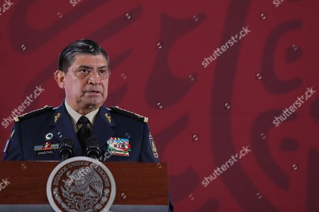The Mexican Secretary of National Defense, Luis Cresencio Sandoval, speaks during President's Andres Manuel Lopez Obrador daily press conference in Mexico City, Mexico, 14 October 2019. Lopez Obrador stressed that the problem of insecurity 'is our main concern and occupation.' He said that by putting in the center respect for human rights and the moderate use of force, 'progress is being made without war, without extermination, without raids and without massacres.'