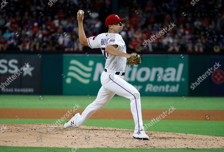 Texas Rangers starting pitcher Brock Burke (70) works against the Seattle Mariners during a baseball game in Arlington, Texas