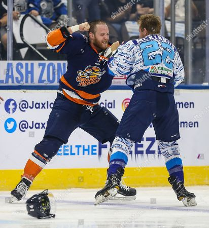 Stock Picture of Less than a minute into the season opener Icemen forward Ian McKinnon (22), right, and Greenville Swamp Rabbits forward Travis Howe (14) drop their gloves and fight during an ECHL professional hockey game at the Veterans Memorial Arena in Jacksonville, Fla., [Gary Lloyd McCullough/CSM]
