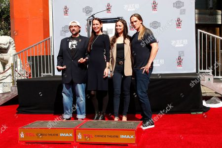 Kevin Smith (L), wife Jennifer Schwalbach Smith, Jordan Monsanto and her husband US actor Jason Mewes (R) during a hand and foot print ceremony for Kevin Smith and Jason Mewes, the stars of 'Jay and Silent Bob Reboot' at the TCL Chinese Theatre IMAX in Hollywood, Los Angeles, California, USA 14 October 2019. The movie opens in the US 17 October 2019.