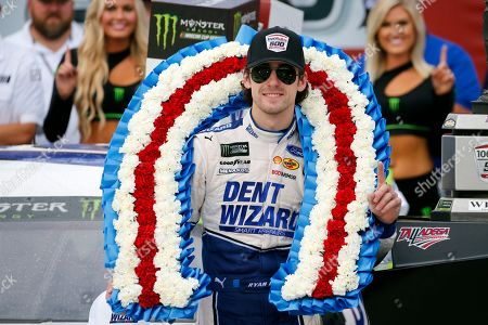 Ryan Blaney celebrates in Victory Lane after winning a NASCAR Cup Series auto race at Talladega Superspeedway, in Talladega, Ala