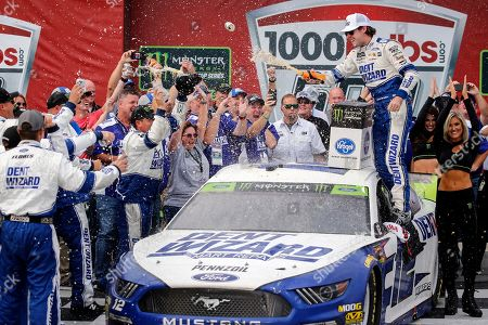 Stock Image of Ryan Blaney celebrates in Victory Lane after winning a NASCAR Cup Series auto race at Talladega Superspeedway, in Talladega, Ala