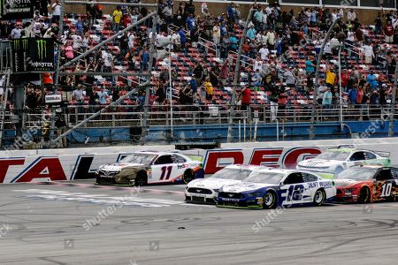 Stock Picture of Ryan Blaney (12) narrowly slides by driver Ryan Newman (6) to take the checkered flag in a NASCAR Cup Series auto race at Talladega Superspeedway, in Talladega, Ala