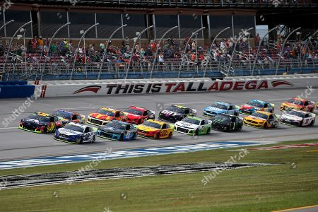 William Byron (24) and Ryan Blaney (12) lead the pack to restart after rain delayed a NASCAR Cup Series auto race at Talladega Superspeedway, in Talladega, Ala