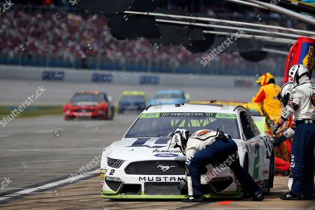 Stock Picture of Brad Keselowski (2) stops for a refueling during a NASCAR Cup Series auto race at Talladega Superspeedway, in Talladega, Ala