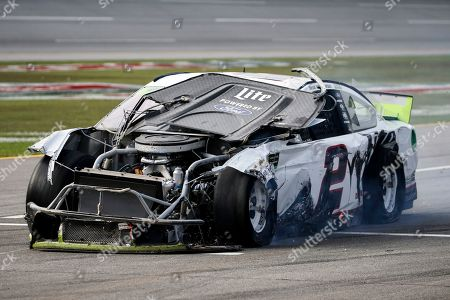 Stock Image of Brad Keselowski (2) drives is damaged car down pit road after a wreck during a NASCAR Cup Series auto race at Talladega Superspeedway, in Talladega, Ala