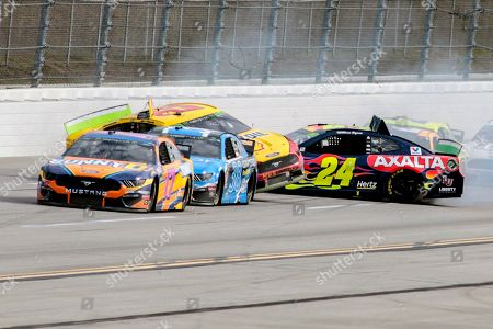 William Byron (24) hits into the side of Joey Logano (22) on the backstretch during a NASCAR Cup Series auto race at Talladega Superspeedway, in Talladega, Ala