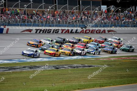 Ryan Blaney (12) leads a pack of cars through the tri-oval during a NASCAR Cup Series auto race at Talladega Superspeedway, in Talladega, Ala