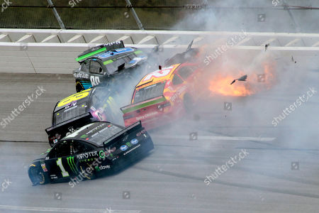 Kurt Busch (1), Jimmie Johnson (48), Alex Bowman (88) and Kyle Larson (42) collide in Turn 3 during a NASCAR Cup Series auto race at Talladega Superspeedway, in Talladega, Ala