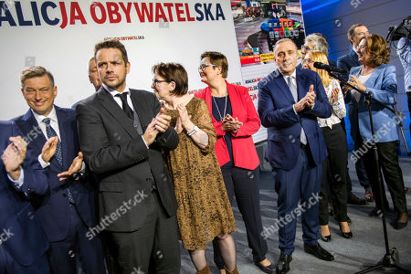 Stock Picture of Rafal Trzaskowski, mayor of Warsaw, Ewa Kopacz, former prime minister, Katarzyna Lubnauer, leader of Nowoczesna (Modern) party, Grzegorz Schetyna, leader of Civic Platform (PO) and Malgorzata Kidawa Blonska on stage watching the preliminary results on a big screen during the event.  Election night of the Civic Coalition and preliminary announcement of results in parliamentary general election. The Civic Coalition is the biggest opponent of the currently ruling party - PiS.
