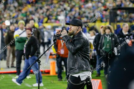 Brantley Gilbert performs during halftime of an NFL football game between the Green Bay Packers and Detroit Lions, in Green Bay, Wis