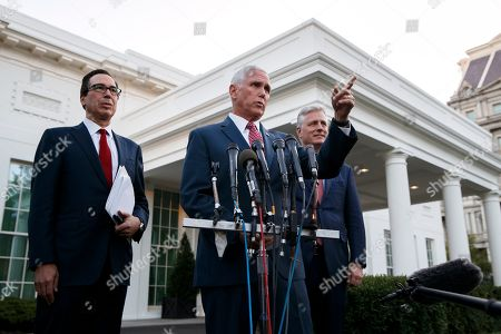 Mike Pence, Steve Mnuchin, Robert O'Brien. Vice President Mike Pence, with Treasury Secretary Steven Mnuchin, left, and national security adviser Robert O'Brien, speaks to reporters outside the West Wing of the White House, in Washington. The U.S. is calling for an immediate ceasefire in Turkey's strikes against Kurds in Syria, and is sending Pence to lead mediation effort