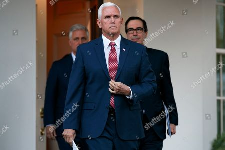 Mike Pence, Steve Mnuchin, Robert O'Brien. Vice President Mike Pence, center, with White House national security adviser Robert O'Brien, left, and Treasury Secretary Steven Mnuchin, left, adjusts his jacket as he approaches reporters outside the West Wing of the White House, in Washington
