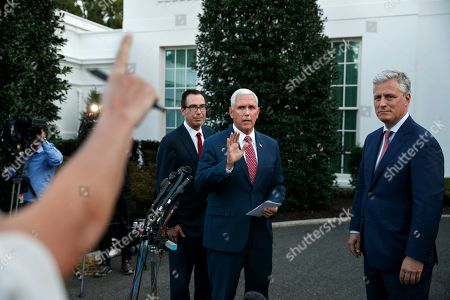 Mike Pence, Steven Mnuchin, Robert O'Brien. Vice President Mike Pence, center, with Treasury Secretary Steven Mnuchin, left, and White House national security adviser Robert O'Brien, waves as he turns to leave after speaking to reporters about Turkey and Syria outside the West Wing of the White House, in Washington
