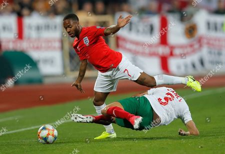 England's Raheem Sterling, left, fights for the ball with Bulgaria's Petar Zanev during the Euro 2020 group A qualifying soccer match between Bulgaria and England, at the Vasil Levski national stadium, in Sofia, Bulgaria