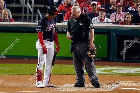 Washington Nationals' Juan Soto argues a call with home plate umpire Bill Miller during the second inning of Game 3 of the baseball National League Championship Series against the St. Louis Cardinals, in Washington