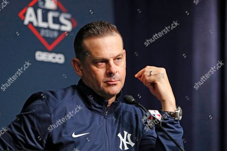 New York Yankees manager Aaron Boone listens to a reporter's question during a press conference, iat Yankee Stadium in New York, one day ahead of Game 3 of the Amerian League Championship Series between the Yankees and the Houston Astros