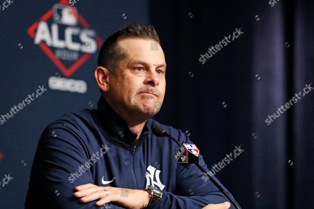 New York Yankees manager Aaron Boone listens to a reporter's question during a press conference, on an off day during the American League Championship Series, at Yankee Stadium in New York. Game 3 is scheduled for Tuesday afternoon in New York