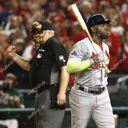 St. Louis Cardinals Marcell Ozuna (R) reacts after striking out swinging on pitches by Washington Nationals starting pitcher Stephen Strasburg as home plate umpire Bill Miller (L) makes the ball during the top of the sixth inning of their MLB National League Championship Series playoff baseball game three at Nationals Park in Washington, DC, USA, 14 October 2019. The winner of the National Leauge Championship Series will play the winner of the American League Championships Series in the World Series.