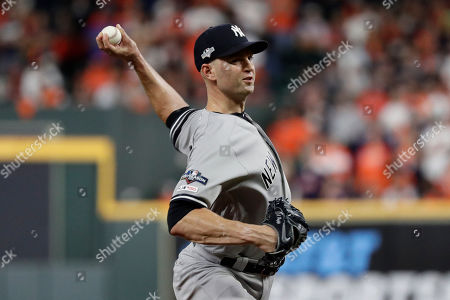 New York Yankees pitcher J.A. Happ throws against the Houston Astros during the 11 inning in Game 2 of baseball's American League Championship Series in Houston. Happ is likely to be among the pitchers the Yankees use in Game 4, manager Aaron Boone said . Happ gave up a game-ending home run to Houston's Carlos Correa in Game 2
