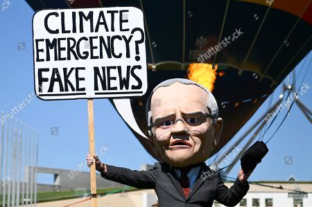 A puppet depicting Australian Prime Minster Scott Morrison is seen during a Climate Change rally outside Parliament House in Canberra, Australia, 15 October 2019.