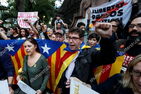 People with Catalan flags protest outside the Spanish embassy for the sentence ruled by the Spanish Supreme Court on 'proces' trial, in Mexico City, Mexico, 14 October 2019. Spanish Supreme Court condemned Oriol Junqueras to 13 years in jail for sedition, Carme Forcadell to 11 years and half for sedition; Jordi Cuixart and Jordi Sanchez were sentenced to nine and a half years for sedition; former regional Minister Jordi Turull, Raul Romeva and Dolors Bassa were sentenced to 12 years in jail for sedition and missapropriation, and Joaquin Forn and Josep Rull were condenmend 10 years an half for sedition. The three other defendants were absolved.