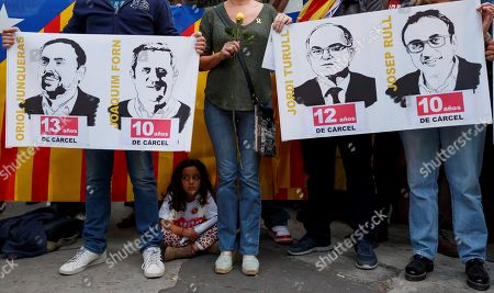 Stock Image of People with Catalan flags protest outside the Spanish embassy for the sentence ruled by the Spanish Supreme Court on 'proces' trial, in Mexico City, Mexico, 14 October 2019. Spanish Supreme Court condemned Oriol Junqueras to 13 years in jail for sedition, Carme Forcadell to 11 years and half for sedition; Jordi Cuixart and Jordi Sanchez were sentenced to nine and a half years for sedition; former regional Minister Jordi Turull, Raul Romeva and Dolors Bassa were sentenced to 12 years in jail for sedition and missapropriation, and Joaquin Forn and Josep Rull were condenmend 10 years an half for sedition. The three other defendants were absolved.