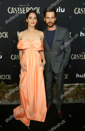 "Stock Image of Lizzy Caplan, Tom Riley. Lizzy Caplan, left, and Tom Riley attend the LA Premiere of Hulu's ""Castle Rock"" Season 2, in West Hollywood, Calif"