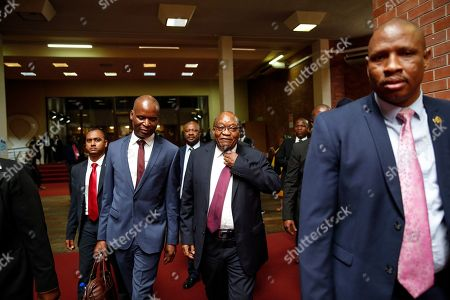 South Africa's former president Jacob Zuma (C) arrives the Pietermaritzburg High Court where he is appearing on corruption charges, Pietermaritzburg, South Africa, 15 October 2019. Former president Zuma stands accused of taking kickbacks before he became president from a 51-billion-rand (3.4 billion USD) purchase of fighter jets, patrol boats and military equipment manufactured by five European firms, including French defence company Thales.