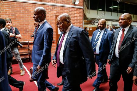 Stock Photo of South Africa's former president Jacob Zuma (C) arrives the Pietermaritzburg High Court where he is appearing on corruption charges, Pietermaritzburg, South Africa, 15 October 2019. Former president Zuma stands accused of taking kickbacks before he became president from a 51-billion-rand (3.4 billion USD) purchase of fighter jets, patrol boats and military equipment manufactured by five European firms, including French defence company Thales.