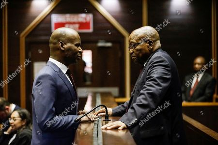 South Africa's former president Jacob Zuma (R) appears at the Pietermaritzburg High Court on corruption charges in, Pietermaritzburg, South Africa, 15 October 2019. Former president Zuma stands accused of taking kickbacks before he became president from a 51-billion-rand (3.4 billion USD) purchase of fighter jets, patrol boats and military equipment manufactured by five European firms, including French defence company Thales.