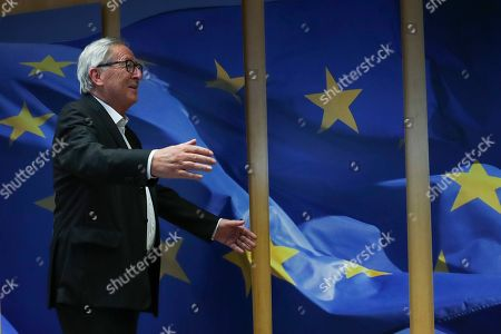 European Commission President Jean-Claude Juncker welcomes incoming European Commissioner for Economy Paolo Gentiloni before their meeting at the EU headquarters in Brussels, . The European Union said Tuesday that a Brexit divorce deal is possible this week but that the British government's proposals so far are not sufficient to seal an agreement