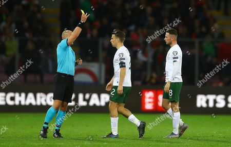 Seamus Coleman of Republic of Ireland is shown a yellow card after a coming together with Granit Xhaka of Switzerland
