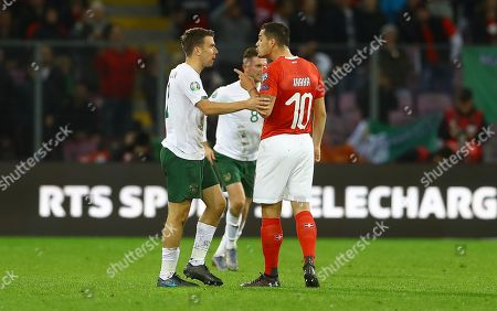 Seamus Coleman of Republic of Ireland and Granit Xhaka of Switzerland are both booked after a coming together