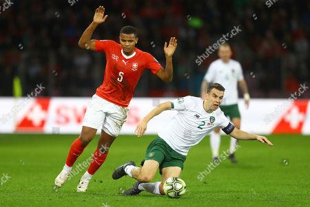 Seamus Coleman of Republic of Ireland is fouled by Manuel Akanji of Switzerland