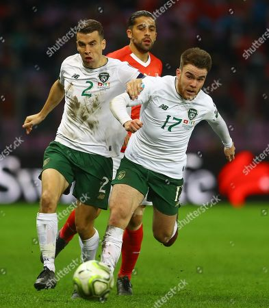 Aaron Connolly and Seamus Coleman of Republic of Ireland go past Ricardo Rodriguez of Switzerland