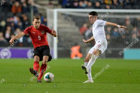 Stock Picture of Phil Foden of England Under-21 and Valentino Muller of Austria Under-21 in action during the UEFA Under 21 Championship Qualifier between England Under-21and Austria Under-21 at the Stadium Mk in Milton Keynes, UK - 15th October 2019